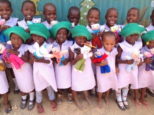Children with their knitted teddies